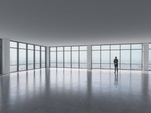 man standing in big open floor