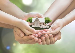 people holding model house - trusts & estate
